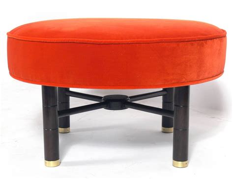 modern heirloom tomato orange velvet ottoman with brass