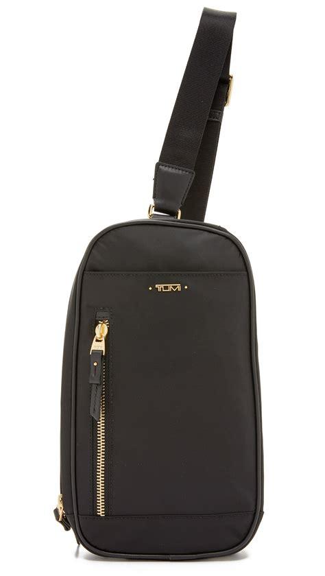 tumi mila small sling bag in black lyst