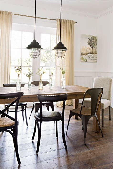 mix match dining tables  chairs create  eclectic