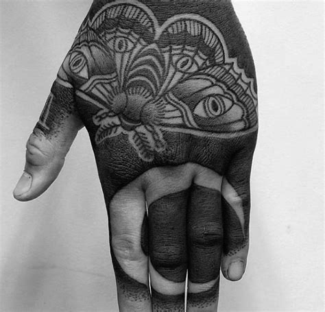 black hand tattoo 70 all black tattoos for blackout design ideas