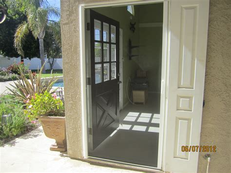 exterior door with screen exterior view retracted single retractable screen door