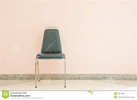 The Chair Is Against The Wall by Chair Against Wall Stock Photos Image 34977503