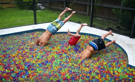 Backyard Scientist Whee Jumping In A Pool Full Of Water Balls Geekologie