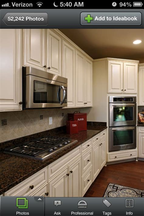 Glazed Cabinets Out Of Style biscotti with cocoa glaze cabinets and brown granite