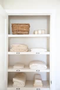 organize a hall linen closet