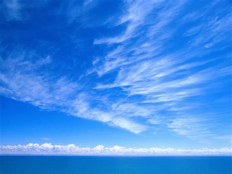wallpaper biru air wallpaper sky blue sky clouds sea clear simple