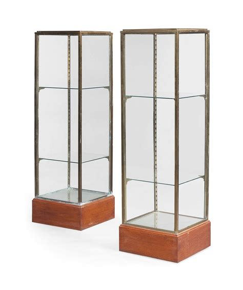 brass and glass display cabinet a pair of brass and glass display cabinets mid 20th