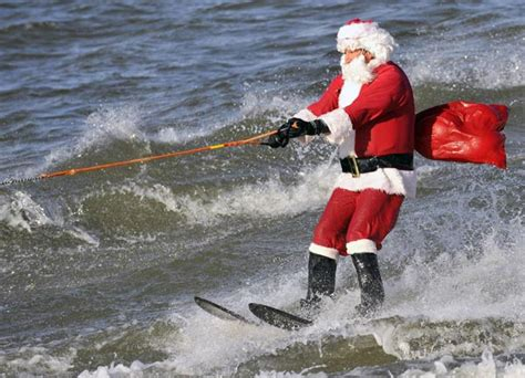 santa on surfboard surfing santa claus