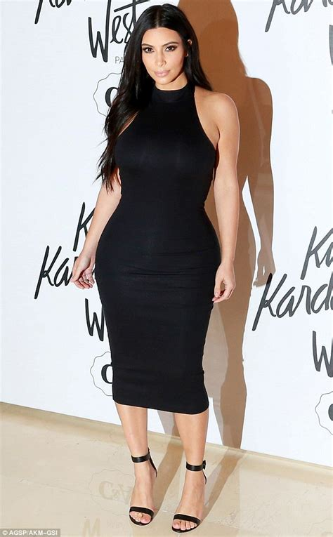 kim kardashian stuns  tight black dress booty shooty