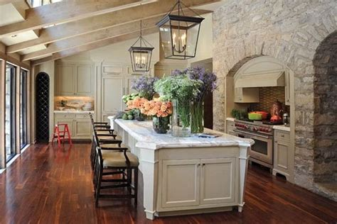 french farmhouse kitchen design decorative stone wall decor with aged wooden beam ceiling