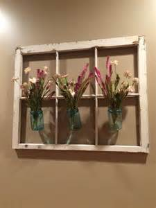 window frame decor floral arrangements jars and masons on