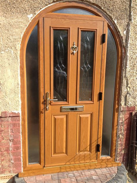 Upvc Bow Windows light oak composite door in arched frame falcon windows