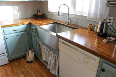 our acacia butcher block counters blue cabinets