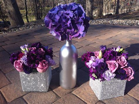 Purple Flowers Centerpieces Silver Wine Bottles Purple Purple And Silver Wedding Centerpiece Ideas