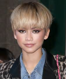 hairstyles for super bowl party zendaya teams long leopard print coat with double denim