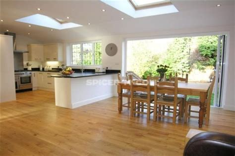 a beautiful kitchen diner extension with roof windows add