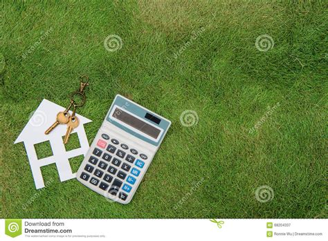 buying a house with no mortgage house with a home environment green living mortgage calculator stock photo image
