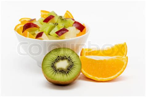 Hexagon Pineaple Apple Kiwi fruit salad with apple orange kiwi and pineapple stock photo colourbox