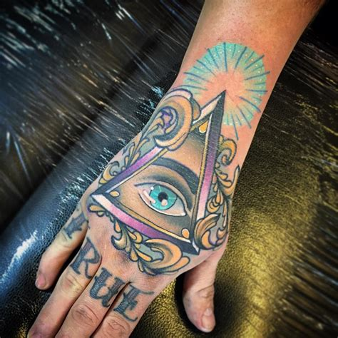 hand eye tattoo triangle eye on best ideas gallery