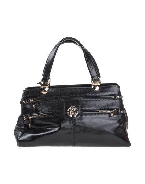 Roberto Cavallis Has Packed Bags by Lyst Roberto Cavalli Handbag In Black
