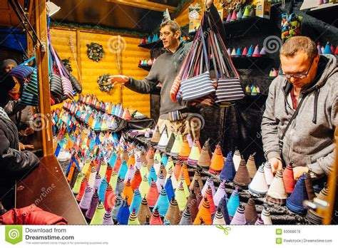 man selling christmas souvenirs editorial stock image