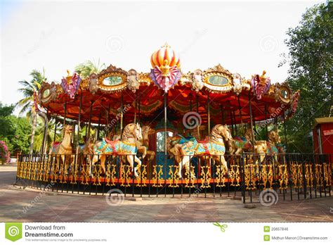 The Roundhouse Themes | merry go round in empty theme park royalty free stock