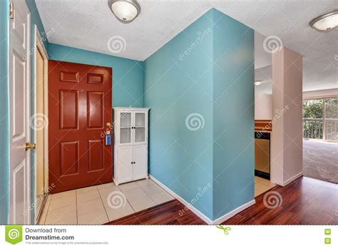 light blue walls and brown wooden doors 3d house free apartment hallway interior with blue walls tile and wood