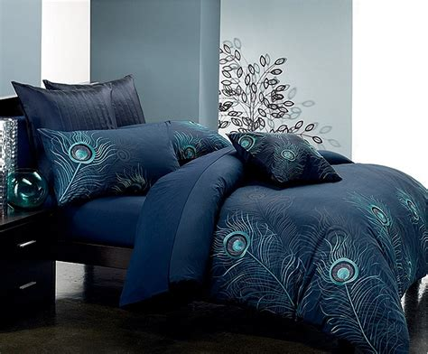 peacock comforter set dark blue and cream stripped on the white base bedding