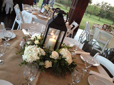 White Lantern And Hydrangea Centerpiece Botanika Wedding Wedding Lantern Centerpieces