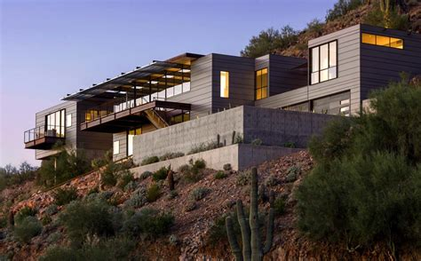 concrete glass and steel structure hovers above arizona