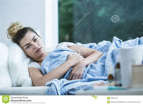 lying on the bed sick woman lying in bed stock photo image 59955418