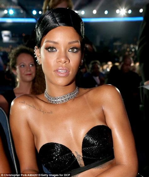 show me a duby wrap rihanna wears bed head hairstyle as she rocks a bra top and sheer skirt to accept the favourite