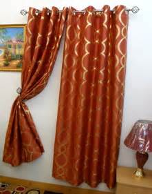 simple family room with burnt orange gold curtains panels