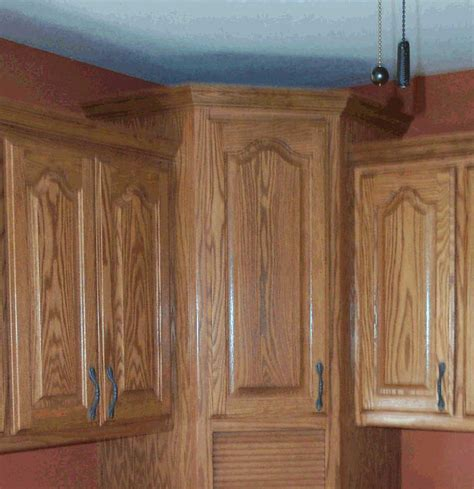 How To Install Crown Molding On Kitchen Cabinets Video by Crown Moulding For Uneven Height Cabinets