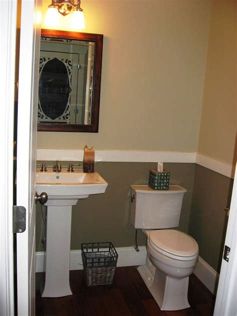 two tone paint bathroom walls pedestal sink dark floors chair rail half bath ideas