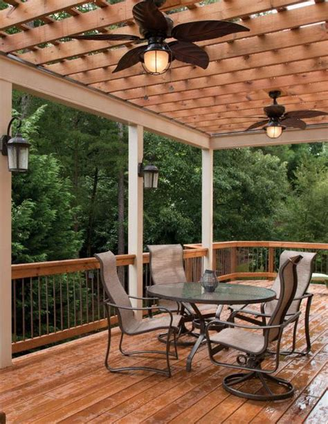 wooded deck area with pergola and ceiling fan outdoor