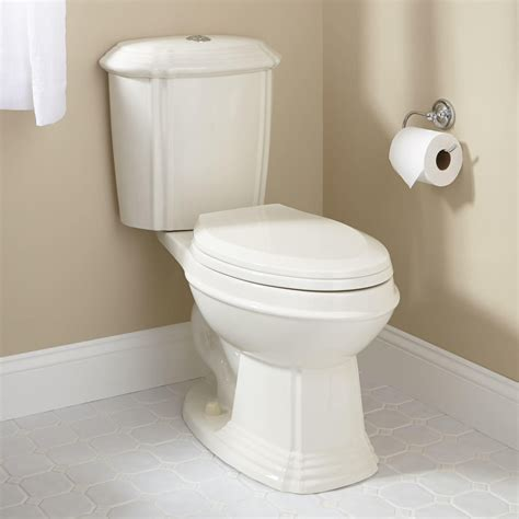 bathroom with two toilets regent dual flush water closet flush button on top