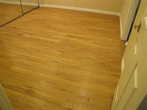 faux wood floors bibbidi bobbidi beautiful our faux wood floor
