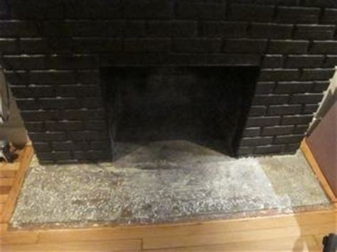 Enlarging fireplace hearth and tiling hearth and surround