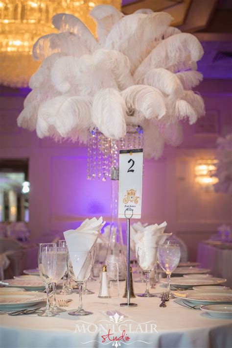ostrich feather chandelier white ostrich feather with chandelier centerpieces by weddings and event design