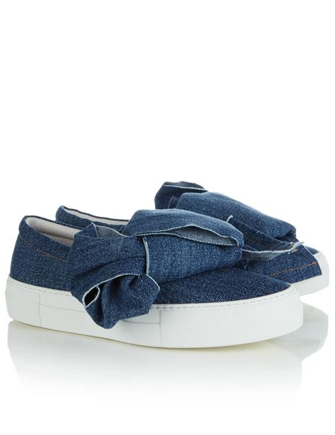sneakers with a bow joshua sanders blue denim bow slip on sneakers in white