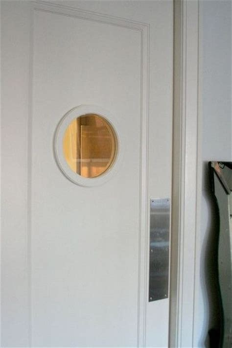 swinging pantry doors porthole swinging door pantry for my kitchen juxtapost
