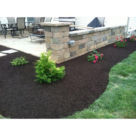 landscape design install around a patio retaining wall