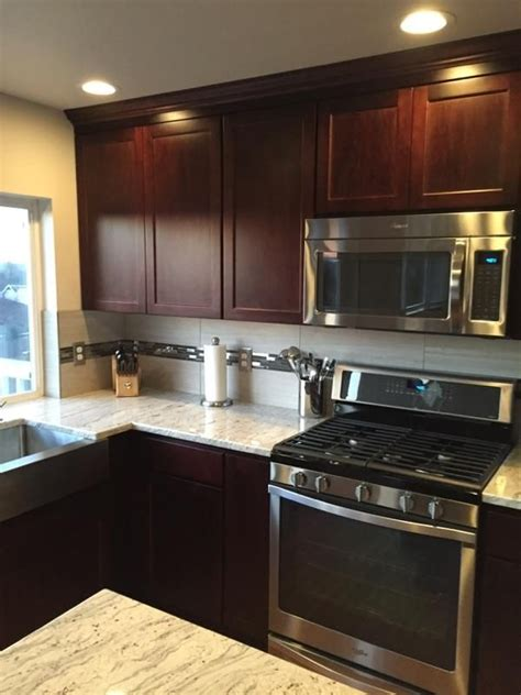 black stainless appliances with cherry cabinets new kitchen with dark cherry cabinets wine river granite