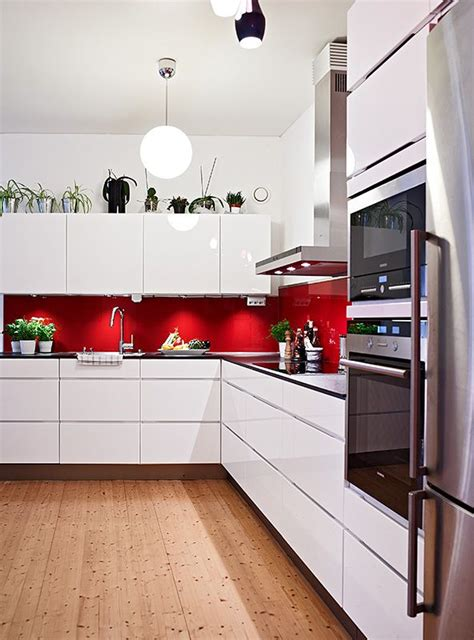 splashback ideas white kitchen red splashback white cabinets silver appliances and wooden