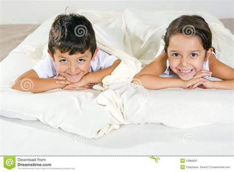 brother and sister in bed brother and sister royalty free stock photography image