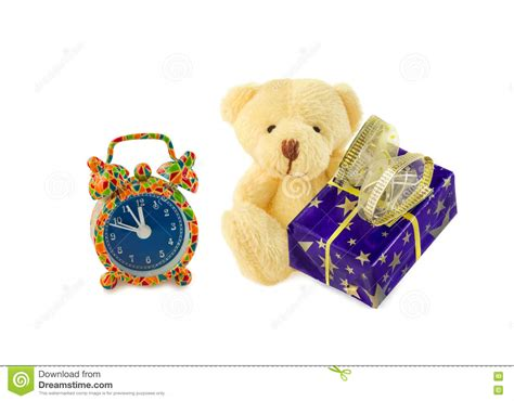 a gift that is soft classic teddy sitting with gift and alarm clock on white stock image image 81346155