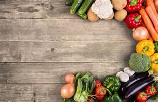 vegetables on wood background with space for text organic