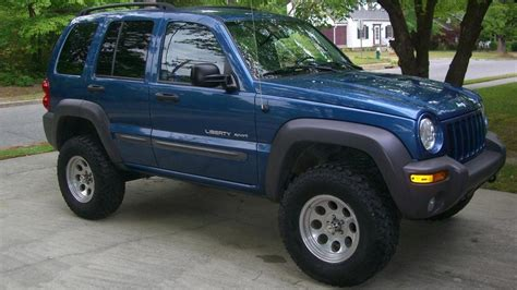 jeep lifted blue bert 2003 sport 4x4 atlantic blue pearl lifted 32s 2003