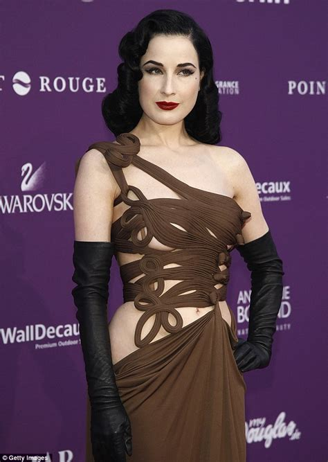 Dita Von Teese dons a very revealing brown gown to the Duftstars Awards in Berlin   Daily Mail